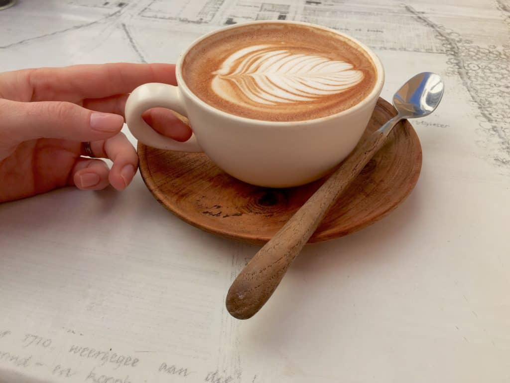 drinking latte thinking about long-term goals